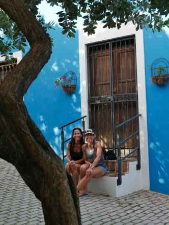 taking a break in front of one of the many colorful buildings